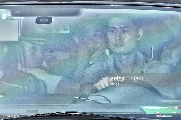 Disgraced politician Bo Xilai leaves in the back of a vehicle after the second day of his trial at the Jinan Intermediate People's Court on August 23...