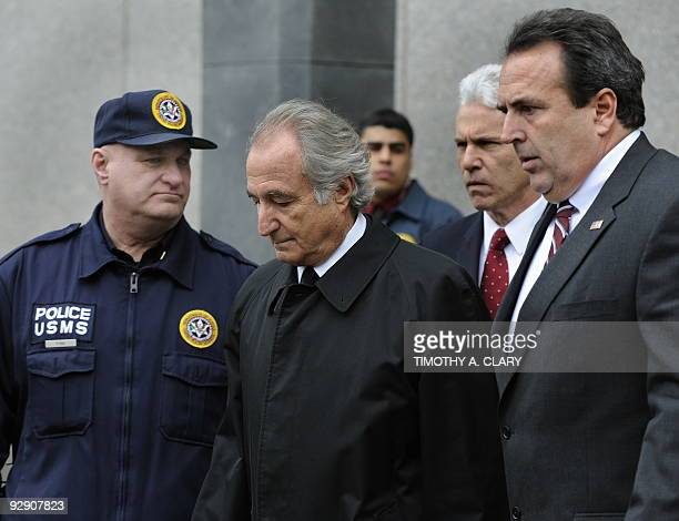 Disgraced Wall Street financier Bernard Madoff leaves US Federal Court after a hearing on March 10 2009 in New York Madoff has agreed to plead guilty...