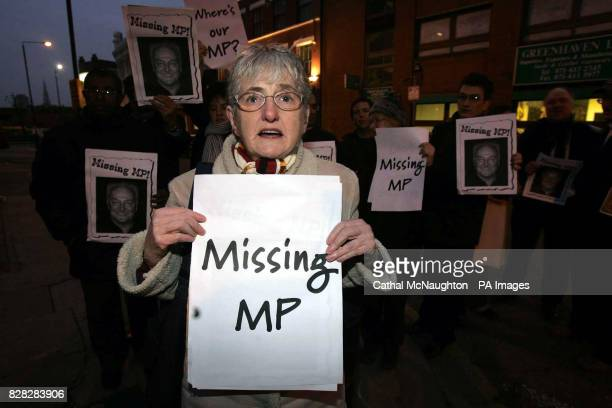 Disgruntled constituent Sybil Yates holds a banner during a protest outside the east London headquarters of the Respect Party Friday January 6 2006...
