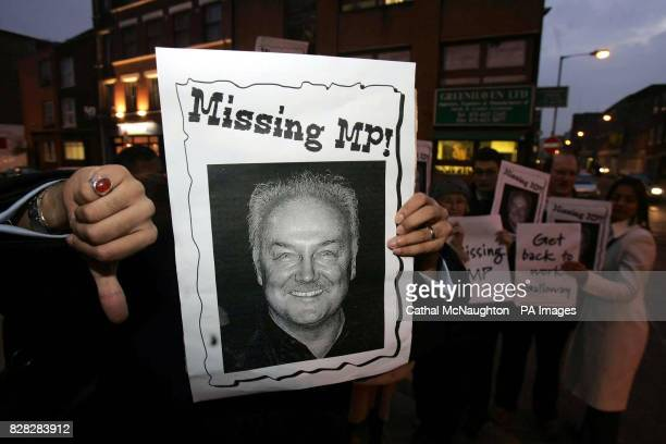 Disgruntled constituents hold a protest outside the east London headquarters of the Respect Party Friday January 6 2006 George Galloway the Respect...