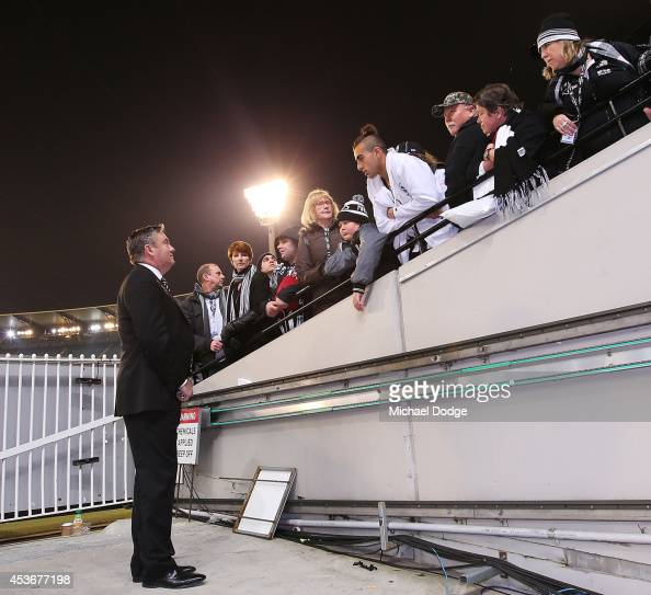Disgruntled magpies fans talk with President Eddie Mcguire after their defeat during the round 21 AFL match between the Collingwood Magpies and the...