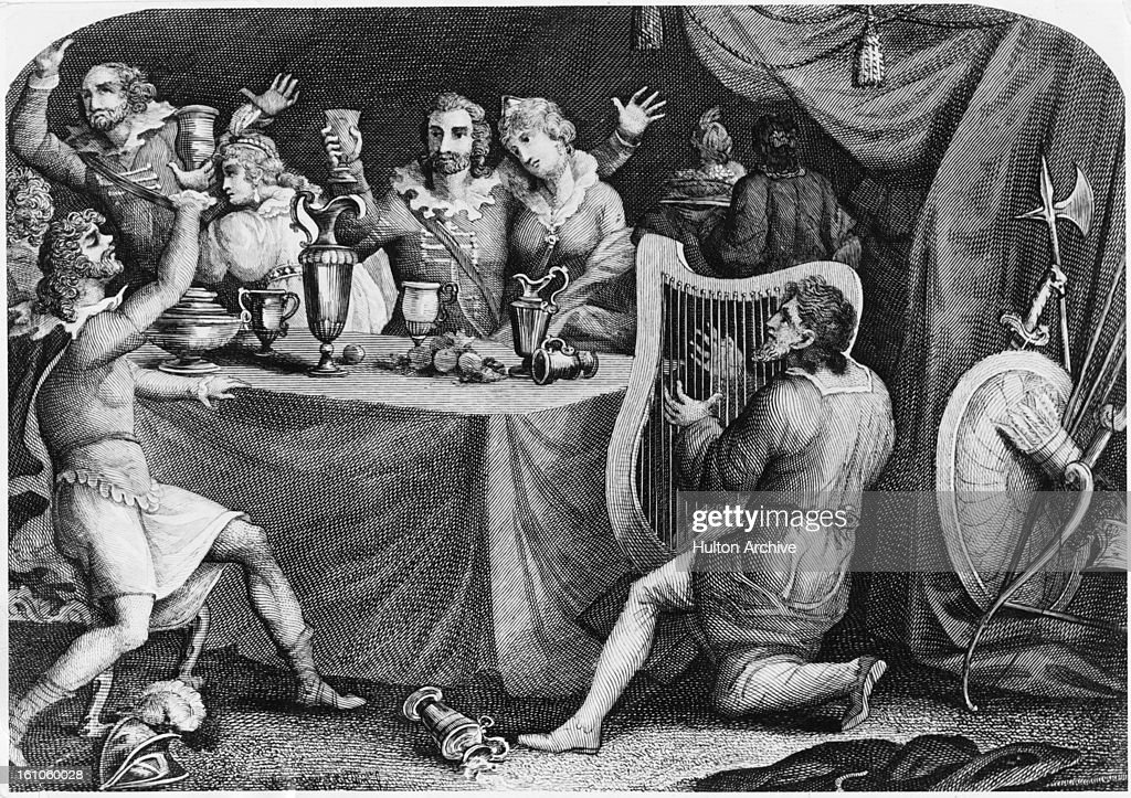 Disguised as a minstrel, King Alfred the Great (849 - 899, right) of Wessex, spies on his Danish enemies at a banquet, circa 890.
