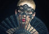 Disguised Beauty hiding behind a Fan