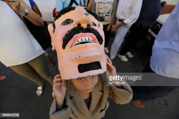 A disguised boy is pictured during the XIII Poetry Festival in Granada some 45 kilometres from Managua on February 15 2017 Poets from America Asia...