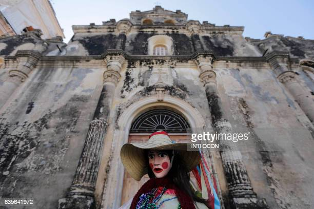 A disguised dancer takes part in the XIII Poetry Festival in Granada some 45 kilometres from Managua on February 15 2017 Poets from America Asia...