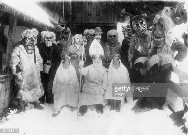 Disguised 'Nikolaus'es and their evil counterparts 'Krampus'es at traditional 'Klaubauf' game im Matrei Eastern Tyrol Photograph About 1935...