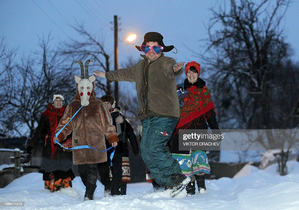 Disguised people walk in Pererov, about 270 km south of Minsk, on January 13, 2012, as they celebrate New Year's eve, according to the Julian calendar.