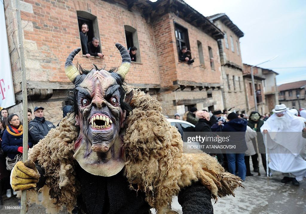 A disguised reveler participates in a carnival procession through south-western Macedonia's village of Vevchani, on January 13, 2013. The Vevchani carnival is 1.400 years old and is held every year on the eve of the feast of Saint Basil ( January 14), which also marks the beginning of the New Year according to the Julian calendar, observed by the Macedonian Orthodox Church.