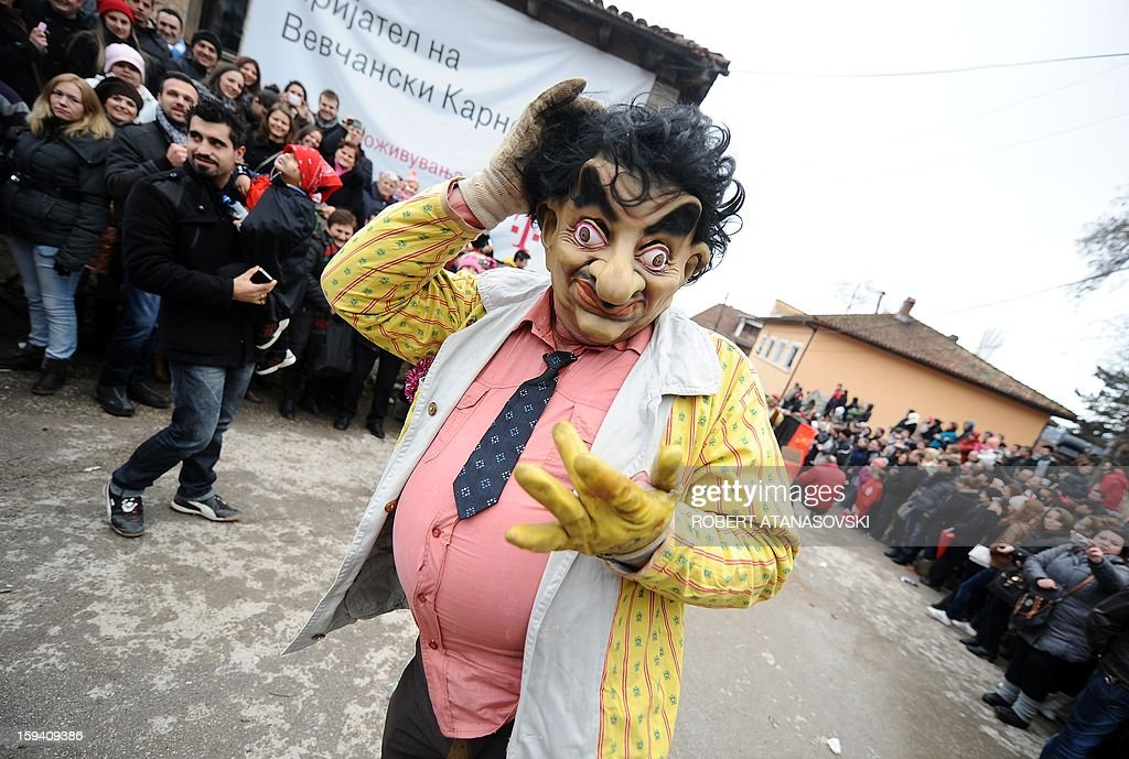 A disguised reveler participates in a carnival procession through south-western Macedonia's village of Vevchani, on January 13, 2013. The Vevchani carnival is 1.400 years old and is held every year on the eve of the feast of Saint Basil ( January 14), which also marks the beginning of the New Year according to the Julian calendar, observed by the Macedonian Orthodox Church. AFP PHOTO/ROBERT ATANASOVSKI