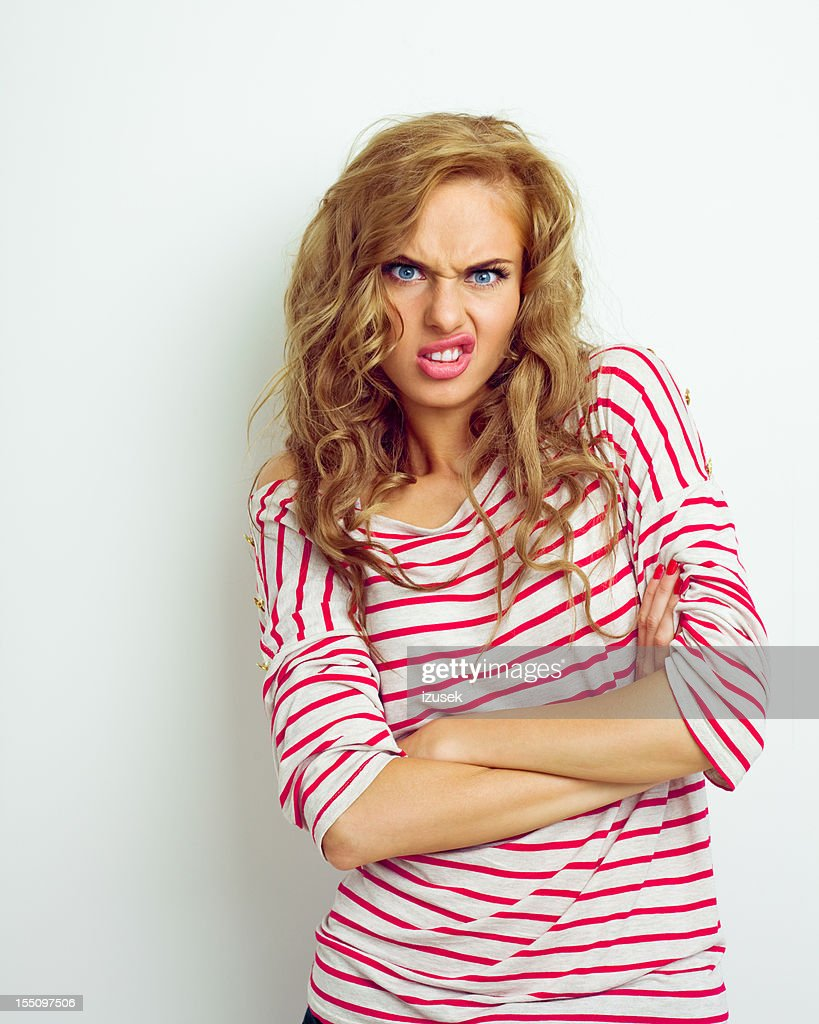 Disgusted young woman : Stock Photo