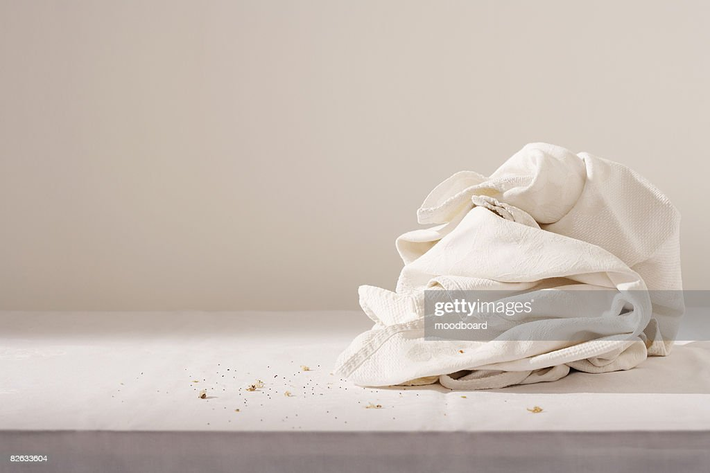 Dish cloth and crumbs on table : Stock Photo
