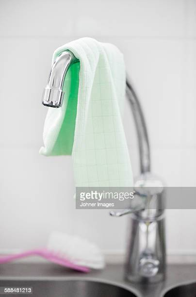 Dish cloth on sink tap