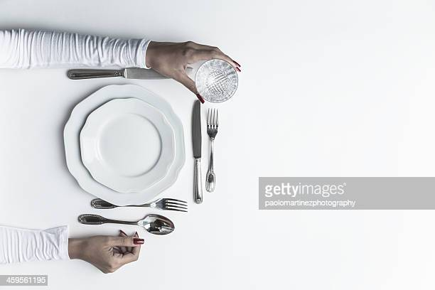 Dish, cutlery, glass and beautiful hands of girl
