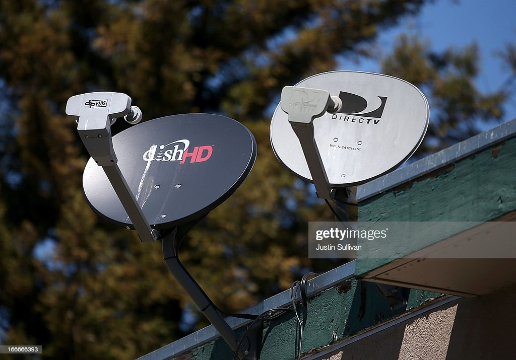 A Dish Network satellite dish (L) is mounted next to a DirecTV dish on the roof of an apartment building on April 15, 2013 in San Rafael, California. Dish Network Corp has offered to purchase Sprint Nextel Corp for $25.5 billion in cash and stock.