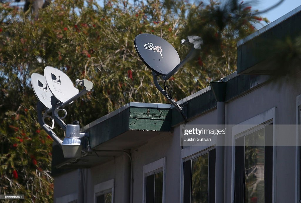A Dish Network satellite dish (R) is mounted next to DirecTV dishes on the roof of an apartment building on April 15, 2013 in San Rafael, California. Dish Network Corp has offered to purchase Sprint Nextel Corp for $25.5 billion in cash and stock.