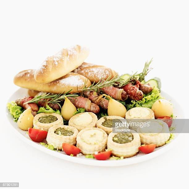 dish of assorted vol-au-vents served with bread and bacon rolls