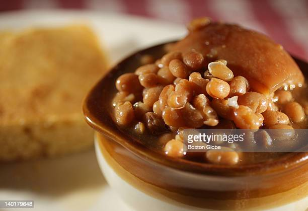 A dish of baked beans with pork in a pot and corn bread from Durgin Park restaurant in Faneuil Hall Market in Boston on February 24 2012