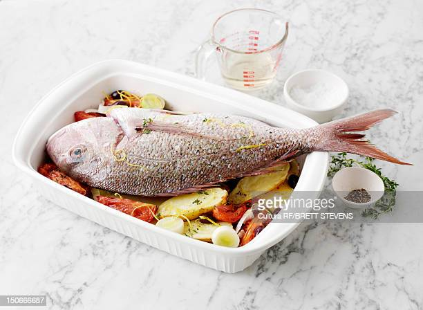 Dish of baked fish with vegetables
