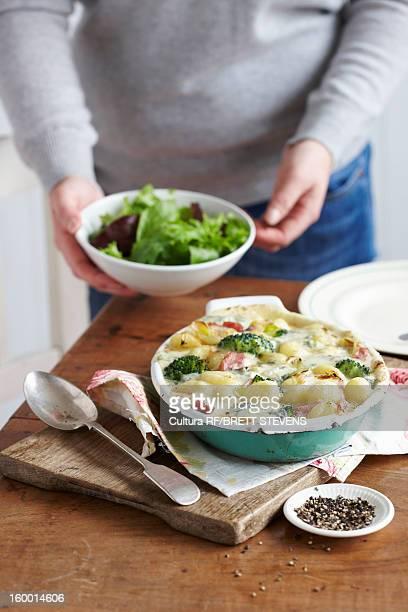 Dish of baked ham and leek gnocchi