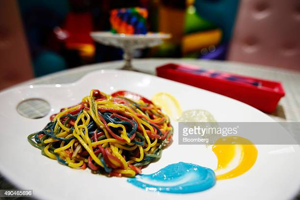 A dish of Colorful Rainbow Pasta is arranged for a photograph at the Kawaii Monster Cafe operated by Diamond Dining Co in the Harajuku area of Tokyo...