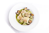 Dish of hake with clams in green sauce