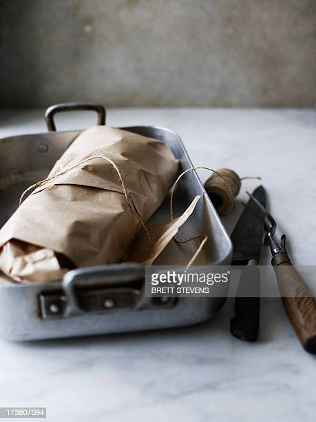 Dish of meat in butchers paper