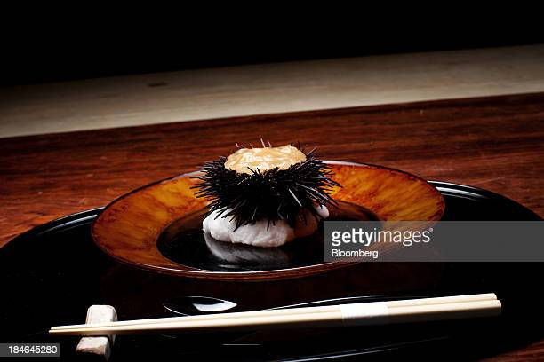 A dish of sea urchin is arranged for a photograph at Azabu Yukimura restaurant in Tokyo Japan on Friday Oct 4 2013 Tokyo's Michelinstarred chefs are...