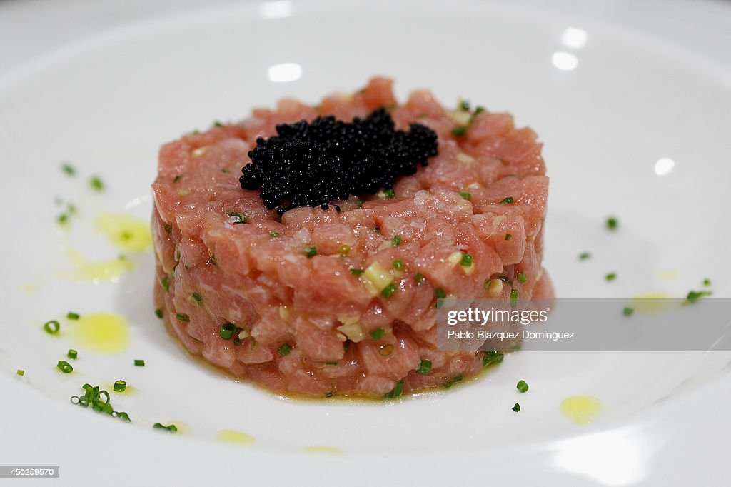 A dish of tuna tartare stands on a table before being served inside El Campero Restaurant during the end of the Almadraba tuna fishing season on June 3, 2014 in Barbate, Cadiz province, Spain. Almadraba is a traditional bluefin tuna fishing method in Southern Spain already used during Phoenician and Romans times. Fishers place mazes of nets to catch tuna migrating from the Atlantic Ocean to the Mediterranean Sea and select those that have the best size. Almadraba tuna is well demanded by Japanese for its quality. Today fishers use a different technique to control the catch amount by releasing many of the bluefin tunas before hauling the nets to avoid exceeding their limited quota fixed by International Commission for the Conservation of Atlantic Tunas 'ICCACT'. Almadraba fishers association claim the fishing quota could now be increased as fishers are struggling and the tuna population has recovered quite well.