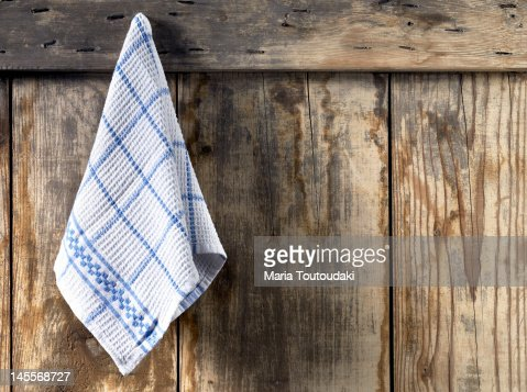 Dishcloth hanging from an old door