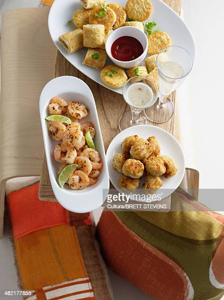 Dishes of prawns with biscuits