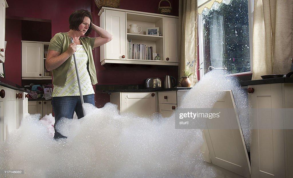 dishwasher malfunction : Stock Photo