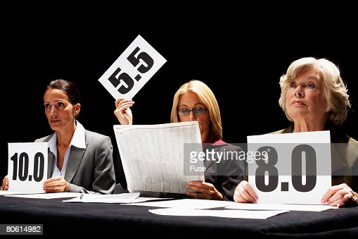 Disinterested Competition Judge Reading Newspaper