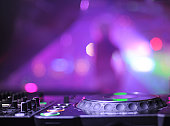 DJ console on the background of dance