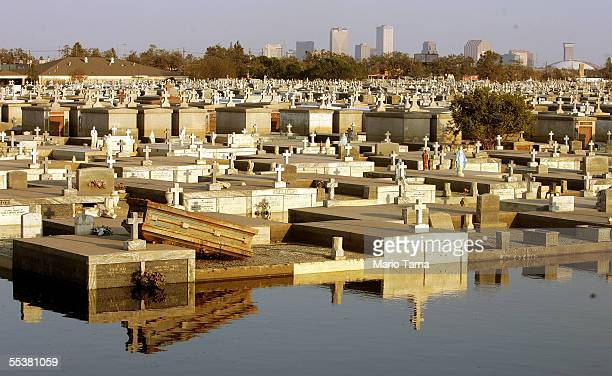 A dislodged coffin is seen overturned on a crypt at a flooded above ground cemetery September 11 2005 in New Orleans Louisiana Rescue efforts and...