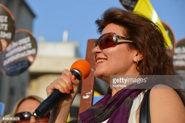 Dismissed academic Nejla Kurul speaks as people protest against the Turkish government's new education policies in Ankara Turkey on September 16 2017...