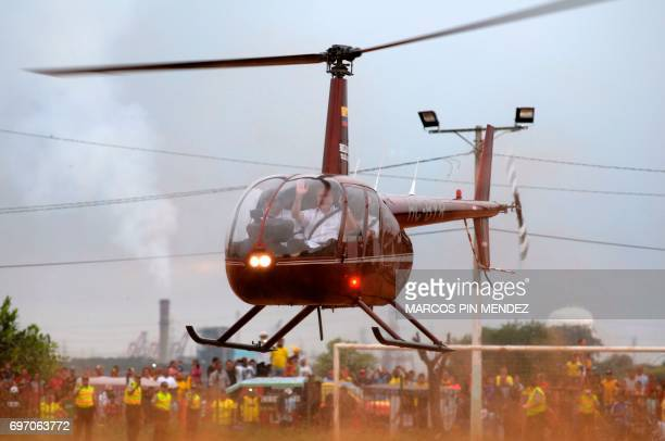 Dismissed Ecuadorean president Abdala Bucaram arrives in a helicopter to attend a political rally after 20 years of exile in Panama in Guayaquil...