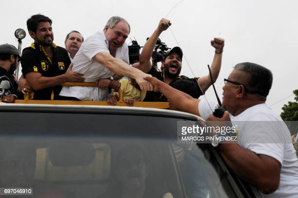 Dismissed Ecuadorean president Abdala Bucaram greets supporters upon arrivl to attend a political rally after 20 years of exile in Panama in...