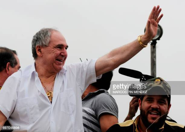 Dismissed Ecuadorean president Abdala Bucaram waves upon arrival in a helicopter to attend a political rally after 20 years of exile in Panama in...