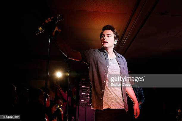 Disney band Forever In Your Mind member Liam Attridge grabs the microphone as he takes the stage to play with his band at Haley Pilot School in...