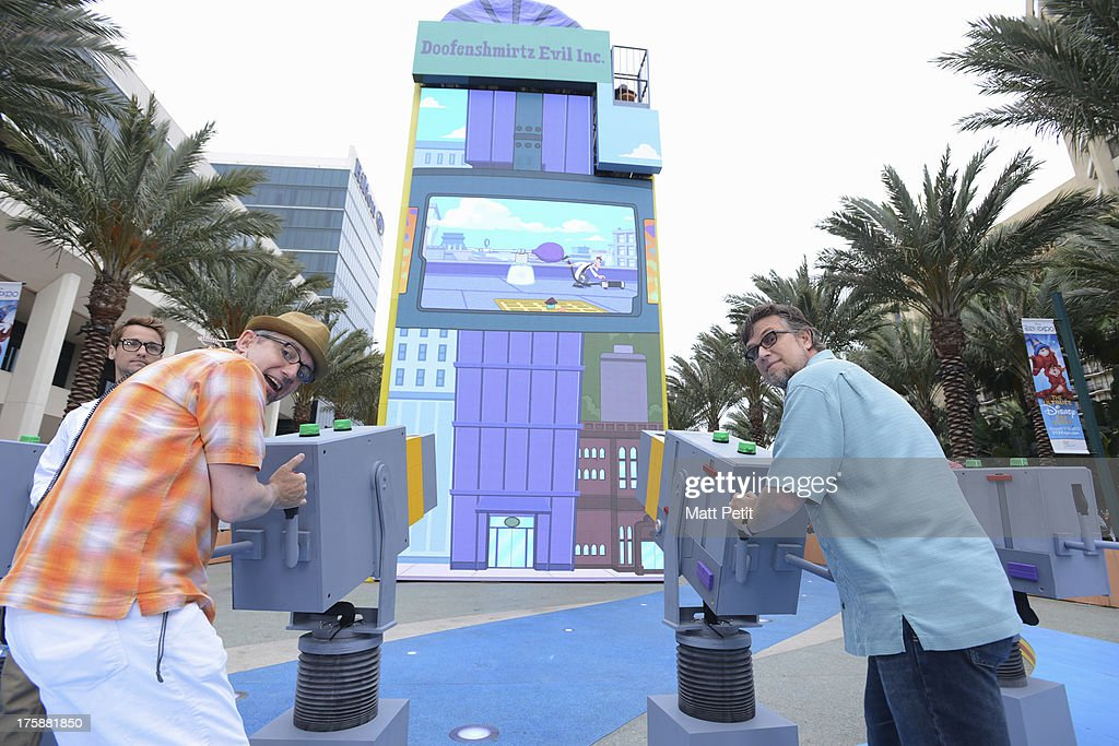 D23 EXPO -Disney Channel unveils Dr. Doofenshmirtz's most wacky '-inator' yet -- 'The Waffle-inator' -- a spectacular 40-foot high interactive game, combining physical and digital worlds -- and rapid-flying waffles -- in an epic showdown to free Agent P from the clutches of Dr. Doofenshmirtz, at Disney's D23 Expo, the ultimate event for Disney fans at the Anaheim Convention Center in Anaheim, California (August 9). 'The Waffle-inator' celebrates the TV crossover special, 'Phineas and Ferb: Mission Marvel,' premiering FRIDAY, AUGUST 16 at 8:00 ET/PT on Disney Channel. Joining the celebration were (Phineas and Ferb or Spider-Man and Iron Man) characters, stars Dan Povenmire (creator/executive producer & 'Dr. Doofenshmirtz'), Swampy Marsh (creator/executive producer & 'Major Monogram'), Vincent Martella ('Phineas'), Alyson Stoner ('Isabella');Marvel Universe stars Drake Bell ('Spider-Man'), Adrian Pasdar ('Iron Man'), Fred Tatasciore ('Hulk') and Travis Willingham ('Thor'). POVENMIRE