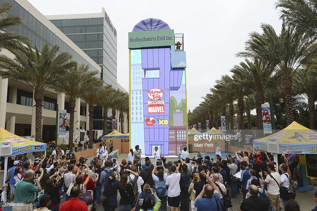 D23 EXPO - Disney Channel unveils Dr. Doofenshmirtz's most wacky '-inator' yet -- 'The Waffle-inator' -- a spectacular 40-foot high interactive game, combining physical and digital worlds -- and rapid-flying waffles -- in an epic showdown to free Agent P from the clutches of Dr. Doofenshmirtz, at Disney's D23 Expo, the ultimate event for Disney fans at the Anaheim Convention Center in Anaheim, California (August 9). 'The Waffle-inator' celebrates the TV crossover special, 'Phineas and Ferb: Mission Marvel,' premiering FRIDAY, AUGUST 16 at 8:00 ET/PT on Disney Channel. Joining the celebration were (Phineas and Ferb or Spider-Man and Iron Man) characters, stars Dan Povenmire (creator/executive producer & 'Dr. Doofenshmirtz'), Swampy Marsh (creator/executive producer & 'Major Monogram'), Vincent Martella ('Phineas'), Alyson Stoner ('Isabella');Marvel Universe stars Drake Bell ('Spider-Man'), Adrian Pasdar ('Iron Man'), Fred Tatasciore ('Hulk') and Travis Willingham ('Thor'). INATOR