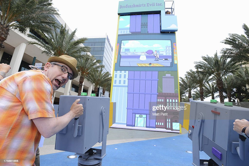 D23 EXPO -Disney Channel unveils Dr. Doofenshmirtz's most wacky '-inator' yet -- 'The Waffle-inator' -- a spectacular 40-foot high interactive game, combining physical and digital worlds -- and rapid-flying waffles -- in an epic showdown to free Agent P from the clutches of Dr. Doofenshmirtz, at Disney's D23 Expo, the ultimate event for Disney fans at the Anaheim Convention Center in Anaheim, California (August 9). 'The Waffle-inator' celebrates the TV crossover special, 'Phineas and Ferb: Mission Marvel,' premiering FRIDAY, AUGUST 16 at 8:00 ET/PT on Disney Channel. Joining the celebration were (Phineas and Ferb or Spider-Man and Iron Man) characters, stars Dan Povenmire (creator/executive producer & 'Dr. Doofenshmirtz'), Swampy Marsh (creator/executive producer & 'Major Monogram'), Vincent Martella ('Phineas'), Alyson Stoner ('Isabella');Marvel Universe stars Drake Bell ('Spider-Man'), Adrian Pasdar ('Iron Man'), Fred Tatasciore ('Hulk') and Travis Willingham ('Thor'). MARSH