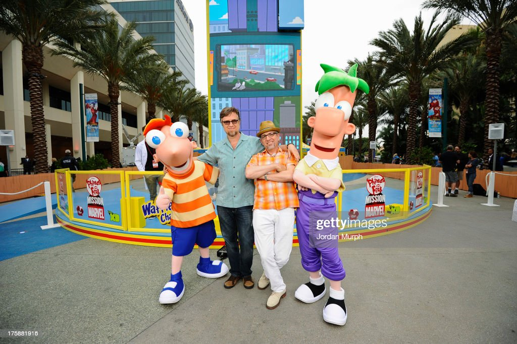 D23 EXPO -Disney Channel unveils Dr. Doofenshmirtz's most wacky '-inator' yet -- 'The Waffle-inator' -- a spectacular 40-foot high interactive game, combining physical and digital worlds -- and rapid-flying waffles -- in an epic showdown to free Agent P from the clutches of Dr. Doofenshmirtz, at Disney's D23 Expo, the ultimate event for Disney fans at the Anaheim Convention Center in Anaheim, California (August 9). 'The Waffle-inator' celebrates the TV crossover special, 'Phineas and Ferb: Mission Marvel,' premiering FRIDAY, AUGUST 16 at 8:00 ET/PT on Disney Channel. Joining the celebration were (Phineas and Ferb or Spider-Man and Iron Man) characters, stars Dan Povenmire (creator/executive producer & 'Dr. Doofenshmirtz'), Swampy Marsh (creator/executive producer & 'Major Monogram'), Vincent Martella ('Phineas'), Alyson Stoner ('Isabella');Marvel Universe stars Drake Bell ('Spider-Man'), Adrian Pasdar ('Iron Man'), Fred Tatasciore ('Hulk') and Travis Willingham ('Thor'). MARSH, FERB