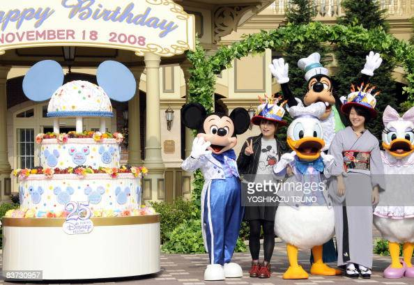 Disney character Mickey Mouse celebrates his 80th birthday with guests who were born on November 18 at a Disneyland hotel in Urayasu in Chiba...