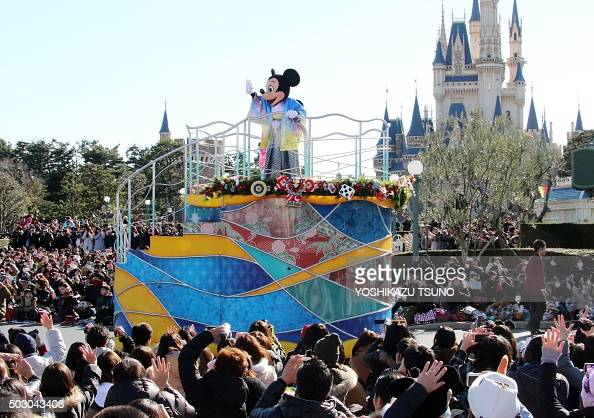 Disney character Mickey Mouse dressed in a traditional Japanese kimono waves to greet guests from a float during the theme park's annual New Year's...