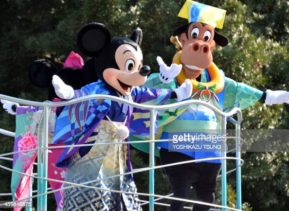Disney character Mickey Mouse dressed in traditional Japanese kimono accompanied by Disney's horse character Horace Horsecollar for the Year of Horse...