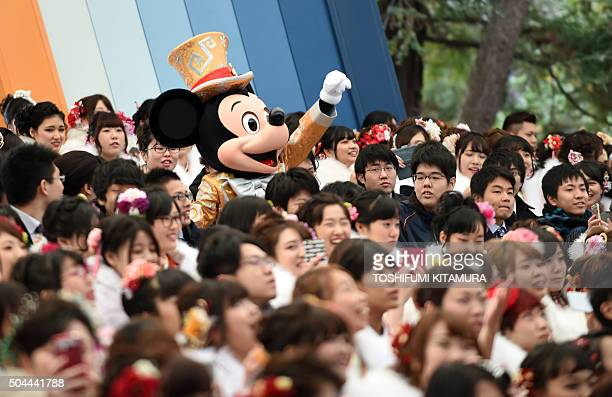 Disney character Mickey Mouse greets 20yearold men and women during their 'ComingofAge Day' celebration at Tokyo Disneyland in Urayasu eastern suburb...