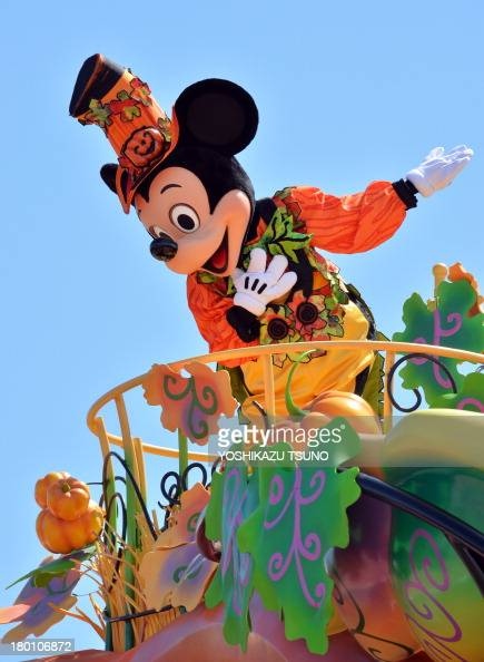 Disney character Mickey Mouse greets guests from a float during a Halloween parade at Tokyo Disneyland in Urayasu suburban Tokyo on September 9 2013...