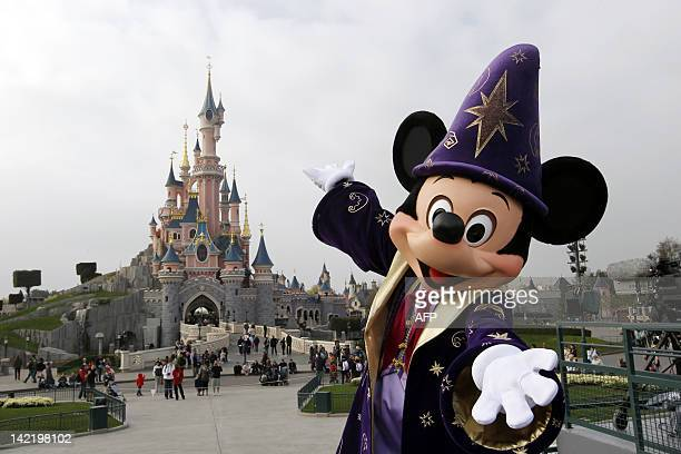 Disney character Mickey poses in front of the Sleeping Beauty Castle at Disneyland park as part of the 20th birthday celebrations of the park in...