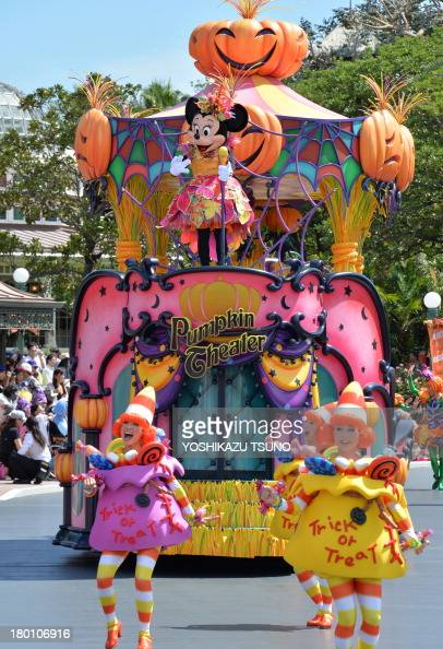 Disney character Minnie Mouse greets guests from a float during a Halloween parade at Tokyo Disneyland in Urayasu suburban Tokyo on September 9 2013...